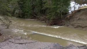 Road washed out by floodwaters in Quebec town